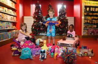 Children with array of toys in shop
