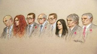 Court sketch showing the eight hacking defendants