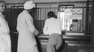 Customers waiting at the registered letter counter of the General Post Office at Khartoum (1950)