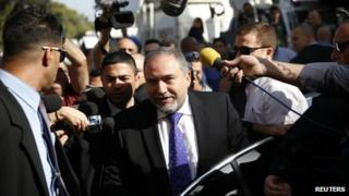 Former Israeli Foreign Minister Avigdor Lieberman arrives to hear the verdict in the corruption charges against him at the Magistrate Court in Jerusalem November 6, 2013