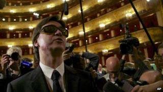 Artistic director of the Bolshoi ballet Sergei Filin, left, speaks to the media after a traditional annual meeting of the Bolshoi Theatre in Moscow, Russia, Tuesday, 17 Sept 2013