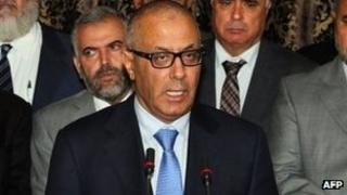 Libyan PM Ali Zeidan (centre) addresses the nation. Photo: 11 October 2013