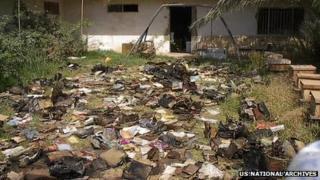 Jewish documents drying outside Saddam Hussein's intelligence agency