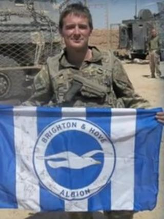 L/Cpl James Brynin holding Seagulls flag