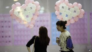 Participants take part in a bachelors' meeting event ahead of Singles Day
