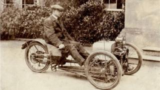Company founder Harry Morgan with the first three-wheeler