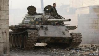 A rebel fighter from Liwa al-Tawhid on board a tank in Aleppo (12 November 2013)