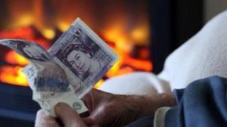 Pensioner holding cash