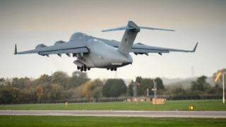 Handout photo issued by the Ministry of Defence of a Royal Air Force 99 Sqn C-17 transport plane as it departs RAF Brize Norton in Oxfordshire