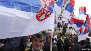 People wave Serbian flags during a rally in Mitrovica. Photo: 15 November 2013