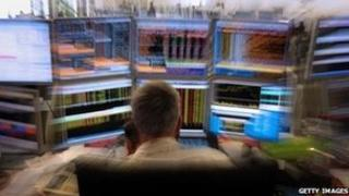 trader in front of screen