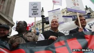 General Secretary Bob Crow (C) and TSSA General Secretary Manuel Cortes (R) join campaign groups protesting outside Oxford Circus tube station against plans to reduce staff on transport routes across the Capital on October 23