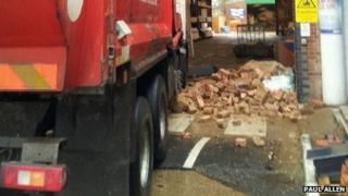 Pile of bricks by the truck's wheels