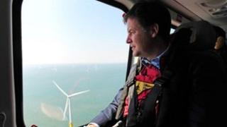 Nick Clegg looks at a wind farm off the Lincolnshire coast.