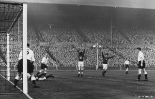 Ferenc Puskas scores Hungary's third goal during the 1953 England-Hungary match