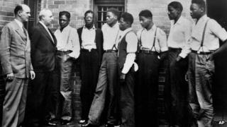 Seven of the nine Scottsboro Boys met with lawyer Samuel Leibowitz (second from left) on 1 May 1935