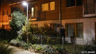 Police standing guard outside flats in south London