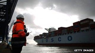 A marine Supervisor monitors the departure of a container ship at Felixstowe