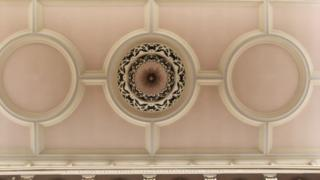 A ceiling in the hall