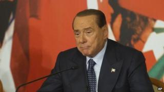 Italian Senator Silvio Berlusconi speaks at a press conference in Rome on 25 November.