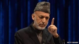 Afghan President Hamid Karzai speaks to the loya jirga on November 24, 2013.