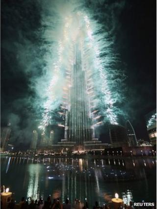 Fireworks are seen as people celebrate after Dubai won the right to host the 2020 World Expo, in front of the Burj Khalifa in Dubai November 27, 2013