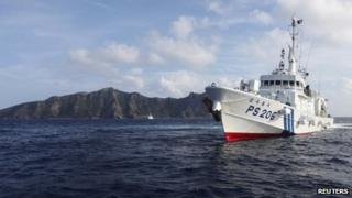 Japan Coast Guard vessel PS206 Houou sails in front of Uotsuri island, one of the disputed islands, called Senkaku in Japan and Diaoyu in China, in the East China Sea on 18 August 2013
