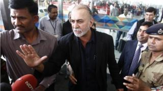 Tarun Tejpal, the 50-year-old founder and editor-in-chief of India's leading investigative magazine Tehelka, speaks with the media upon his arrival at the airport on his way to Goa, in New Delhi 29 November 2013