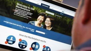 A man looks at the Affordable Care Act sign-up page on the official website.