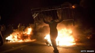 Israel Bedouins burn a police barricade during a protest on 30 November 2013 near Hura, Israel