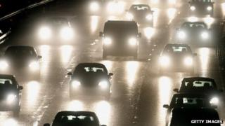 Cars on a motorway during the evening