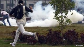 Protester and tear gas, Tahrir 1/12/13