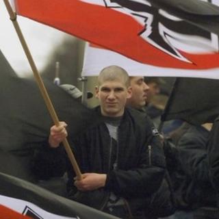 Demonstrator holds a German Reich war flag