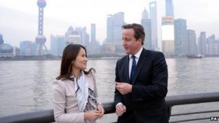 David Cameron talks to Lisa Pan, vice-president of games manufacturer Rekoo, in Shanghai