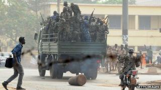 Soldiers crowd a truck in a street of Bamako on March 22, 2012.
