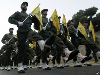 Hezbollah fighters parade through southern Beirut in 2010