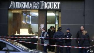 Forensic policemen are seen working in a jewellery store that was attacked in Paris