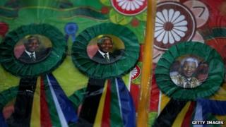Rosettes with Nelson Mandela's face outside his home in Johannesburg