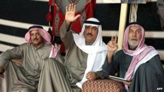 Prominent opposition leader and former MP Mussallam al-Barrak (C) celebrates after a Kuwaiti court acquitted him and dozens of other Kuwaitis