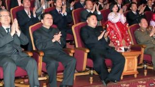 This file picture taken by North Korea's official Korean Central News Agency (KCNA) on 15 April 2013 shows North Korean leader Kim Jong-un (C-front) applauding at the Unhasu orchestra concert, as his uncle, Chang Song-thaek (front 2nd L), looks on