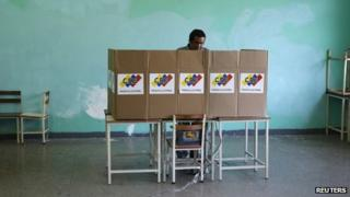 A man votes during municipal elections in Caracas on 8 December, 2013