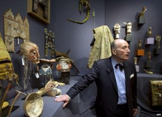 French auctioneer Alan Leroy stands during an auction of sacred objects from the Hopi and San Carlos Apache Native American tribes in Paris, 9 December