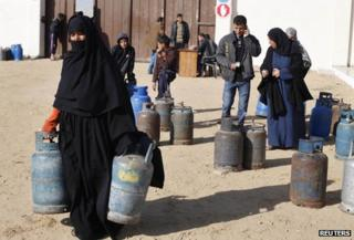 Palestinians collecting gas canisters in Rafah, Gaza - file pic