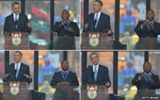 Barack Obama stands next to a sign language interpreter who was widely criticised