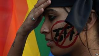 An Indian gay-rights activist takes part in a protest against the Supreme Court ruling reinstating a ban on gay sex in Kolkata on December 11, 2013