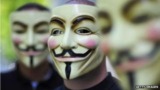Three men with anonymous masks