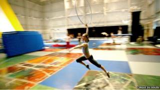 An acrobat trains at Cirque du Soleil's cavernous headquarters in Montreal