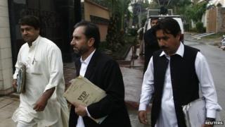 Samiullah Afridi (centre) in October 2013 arrives in court in Peshawar