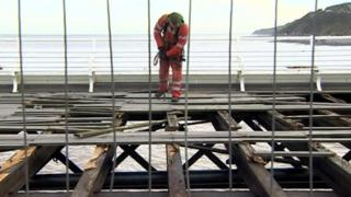 Contractor working on damaged Cromer Pier following