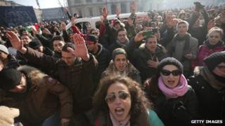 People at a protest against austerity measures in Piazza Castello, Turin, on 11 December